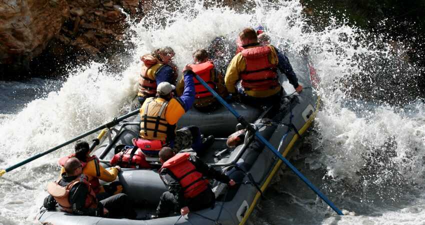 Group paddles through whitewater rapids on the Nenana River.