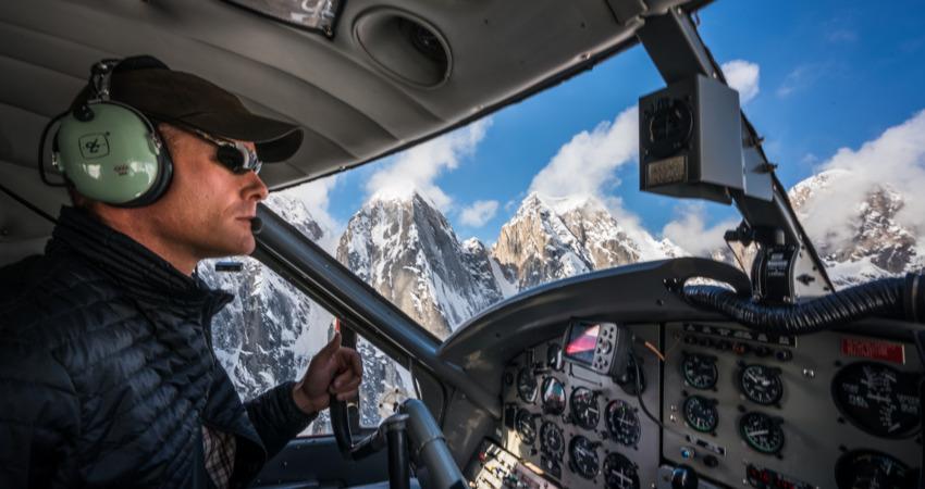 Pilot navigating the K2 Aviation Denali Experience flight.