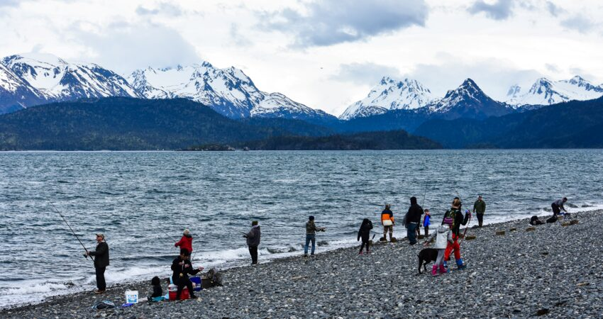 Families fishing off the Homer Spit.