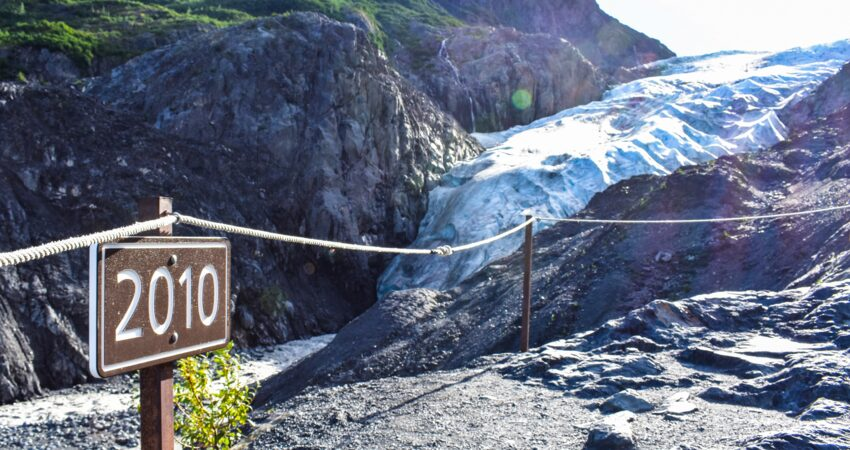 Trail markers show where the toe of the glacier reached in a given year.